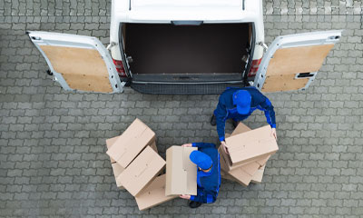 GPS tracking benefit is proof of delivery (POD) with two men unloading boxes from a van