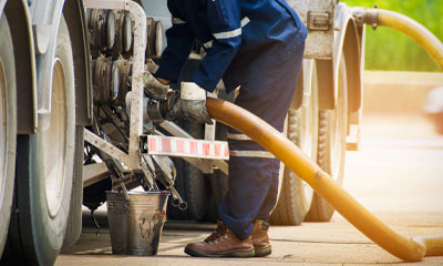 fuel tax credit reporting image with man refuelling vehicle